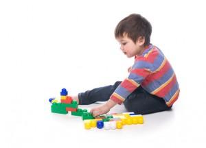 Boy with multicolored bricks